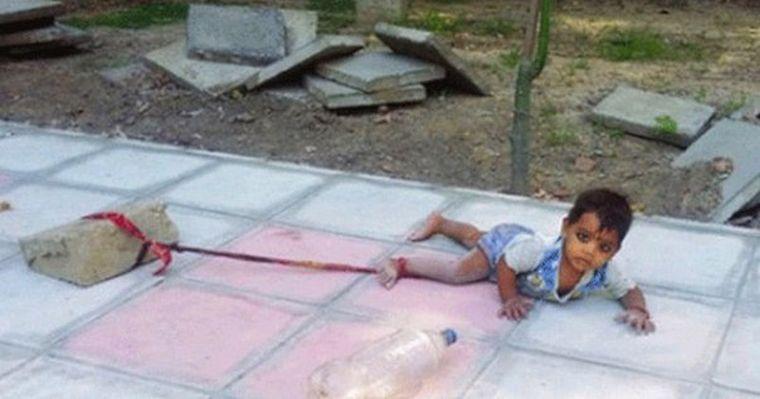 Родители привязали 15 — месячную дочь до бетонного блока на целый день при 40 — градусной жаре