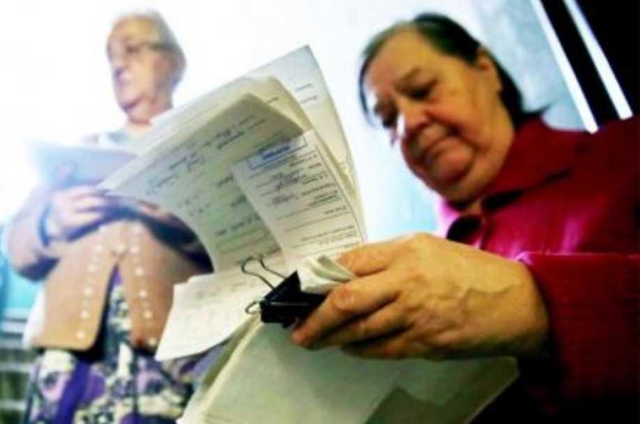 В феврале украинцы получат вдвое больше платежек: как рассчитаться с долгами